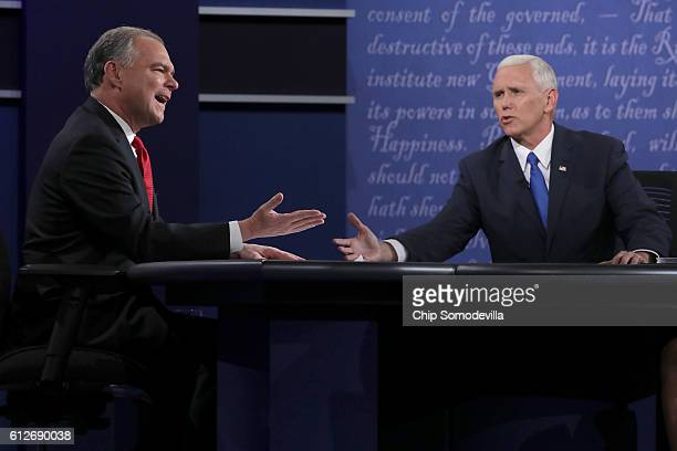 Democratic vice presidential nominee Tim Kaine and Republican vice presidential nominee Mike Pence speak during the Vice Presidential Debate at...