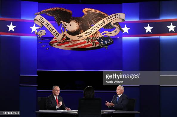 Democratic vice presidential nominee Tim Kaine and Republican vice presidential nominee Mike Pence debate as moderator Elaine Quijano listens during...