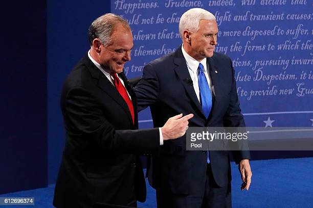 Democratic vice presidential nominee Tim Kaine and Republican vice presidential nominee Mike Pence stand on stage following the Vice Presidential...