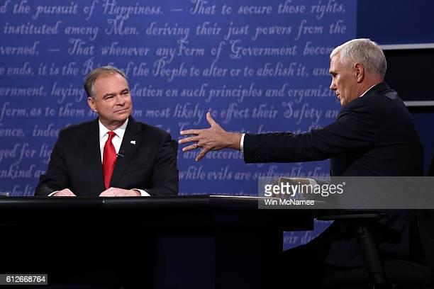 Democratic vice presidential nominee Tim Kaine listens as Republican vice presidential nominee Mike Pence speaks during the Vice Presidential Debate...