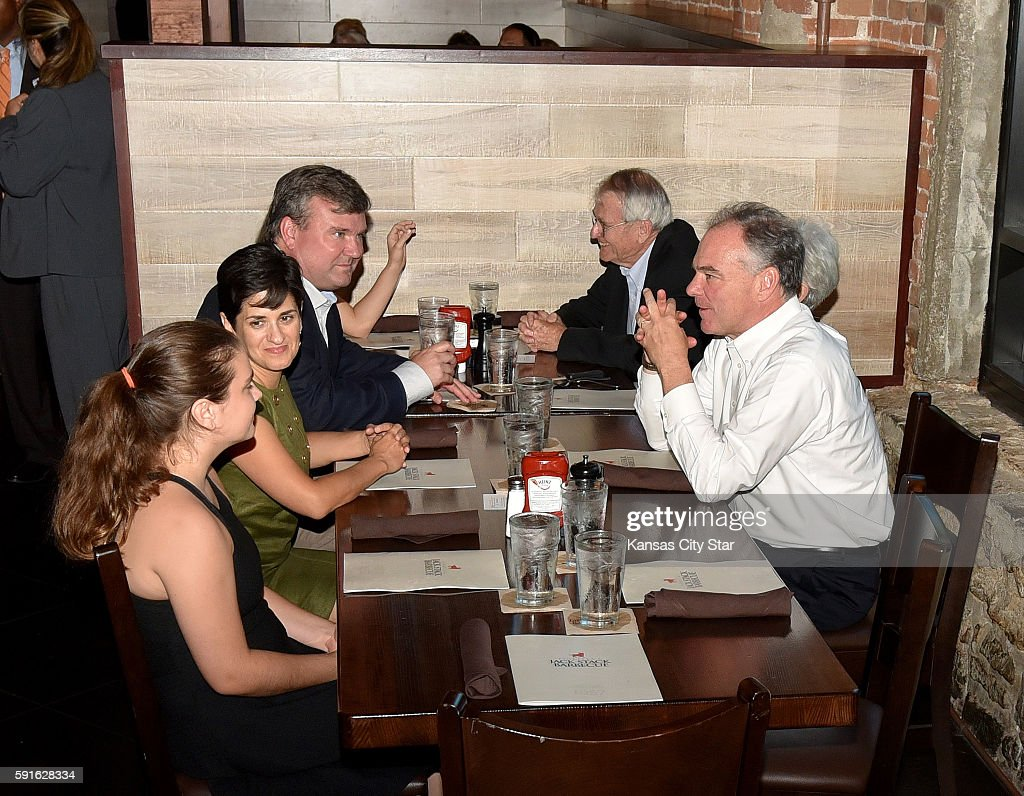 Democratic vice presidential nominee Tim Kaine right sits down to dinner with his parents Kathleen and Al Kaine along with his brother Pat Kaine...