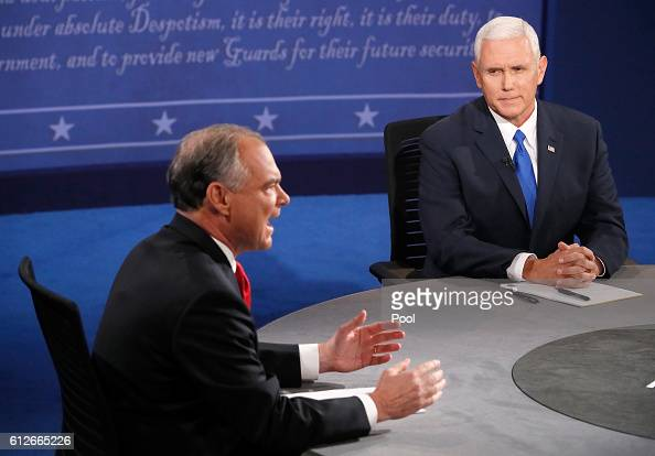 Democratic vice presidential nominee Tim Kaine speaks as Republican vice presidential nominee Mike Pence listens during the Vice Presidential Debate...