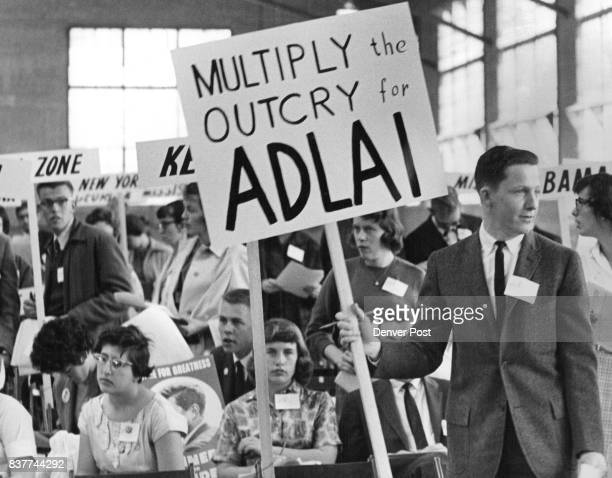 Democrats Mill Around Convention Floor At CSU During Civil Rights Debate Delegate holding the Adlai placard is Bob Sheldon of Sterling Colo a junior...