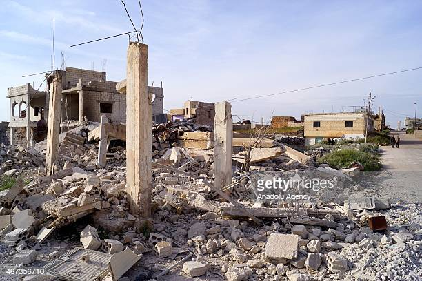 Demolished houses are seen after Assad regime forces attack with barrel bombs to Daraa Syria on March 23 2015