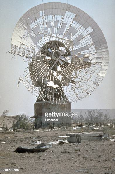 A demolished satellite communications dish in Kuwait remains standing amongst the rubble in the aftermath of Operation Desert Storm