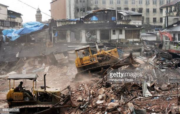 Demolition Bulldozer The demolition of an illegal construction in Munim Compound by BMC officials begins at Musafirkhana The structure was allegedly...