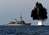 Straits of Hormuz, November 19, 2010 09/14/2009 A demolition charge detonates 1,500 meters from Avenger09/14/2009class mine countermeasures ship USS Scout (MCM09/14/20098). The charge was built and de