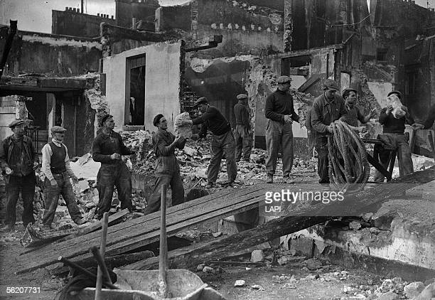 Demolition of a unfit for habitation housing block at the corner of the SaintMartin and Grenier SaintLazare streets Paris 1941