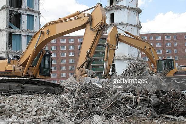 Demolition with cranes and trash