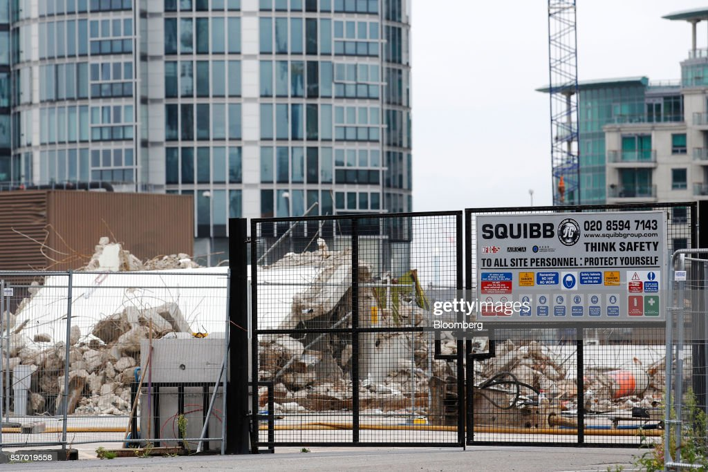 Demolition works takes place at the Nine Elms Square construction site in London, U.K., on Tuesday, Aug. 22, 2017. Billionaire Wang Jianlins Dalian Wanda Group Co. scrapped plans to buy the land plot in London for 470 million pounds ($606 million) amid the Chinese governments intensifying scrutiny of overseas investments. Photographer: Luke MacGregor/Bloomberg via Getty Images