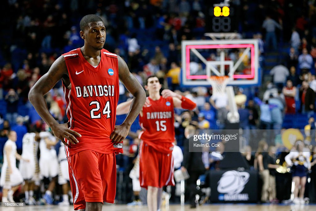 De'Mon Brooks #24 and Jake Cohen #15 of the Davidson Wildcats react after losing 59-58 to the Marquette Golden Eagles during the second round of the 2013 NCAA Men's Basketball Tournament at the Rupp Arena on March 21, 2013 in Lexington, Kentucky.