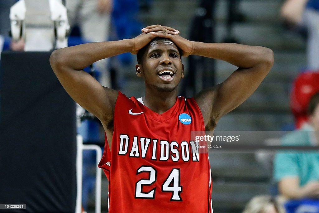 De'Mon Brooks #24 of the Davidson Wildcats reacts after losing the ball to the Marquette Golden Eagles in the second half during the second round of the 2013 NCAA Men's Basketball Tournament at the Rupp Arena on March 21, 2013 in Lexington, Kentucky. Marquette won 59-58.