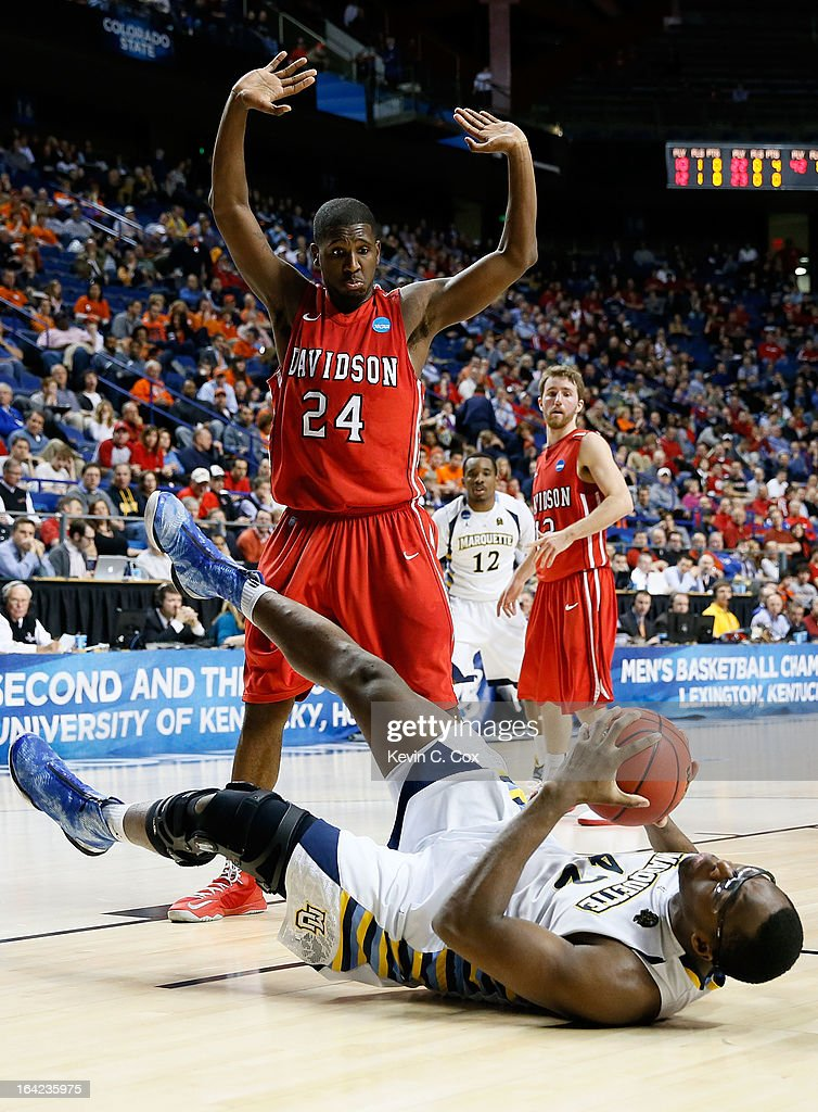 De'Mon Brooks #24 of the Davidson Wildcats reacts showing he did not foul <a gi-track='captionPersonalityLinkClicked' href=/galleries/search?phrase=Chris+Otule&family=editorial&specificpeople=5678342 ng-click='$event.stopPropagation()'>Chris Otule</a> #42 of the Marquette Golden Eagles in the first half during the second round of the 2013 NCAA Men's Basketball Tournament at the Rupp Arena on March 21, 2013 in Lexington, Kentucky.