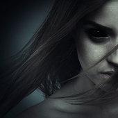 Dark portrait of a possessed woman. Halloween theme.