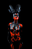 Beautiful demon woman with horns