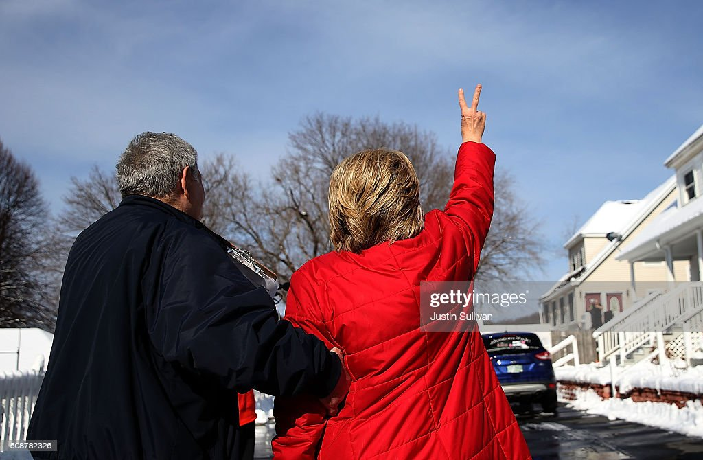 Demoncratic presidential candidate former Secretary of State <a gi-track='captionPersonalityLinkClicked' href=/galleries/search?phrase=Hillary+Clinton&family=editorial&specificpeople=76480 ng-click='$event.stopPropagation()'>Hillary Clinton</a> (R) waves to a resident as she walks with New Hampshire state senator Lou D'Allesandro while knocking on doors to greet voters on February 6, 2016 in Manchester, New Hampshire. With less than one week to go before the New Hampshire primaries, <a gi-track='captionPersonalityLinkClicked' href=/galleries/search?phrase=Hillary+Clinton&family=editorial&specificpeople=76480 ng-click='$event.stopPropagation()'>Hillary Clinton</a> continues to campaign throughout the state.