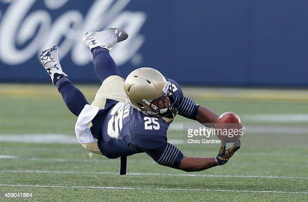 Demond Brown of the Navy Midshipmen tries in vain to catch a pass against the Georgia Southern Eagles during the first half at the NavyMarines...