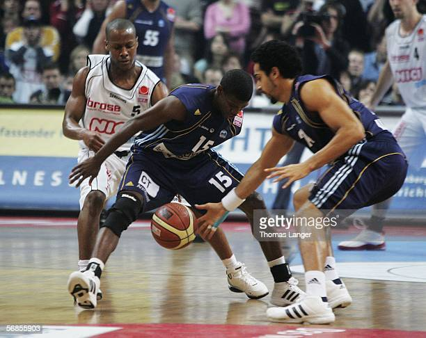 Demond Mallet of Bamberg and Hollis Price and Luke Whitehead of Berlin in action during the Bundesliga match between GHP Bamberg and Alba Berlin on...