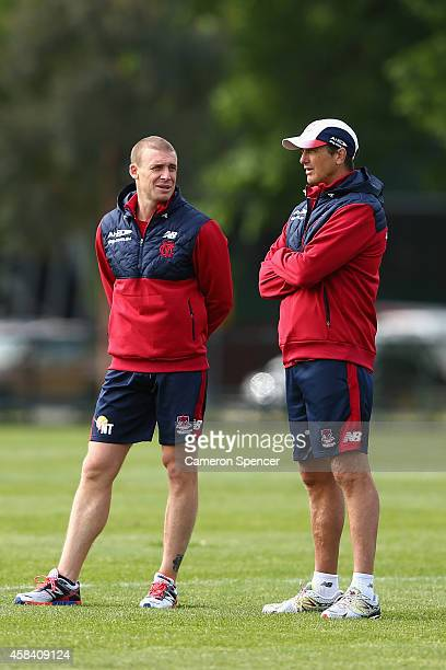 Demons assistant coach Simon Goodwin talks to head coach Paul Roos during a Melbourne Demons AFL training session at Gosch's Paddock on November 5...