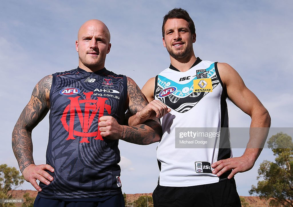 Demons Captain Nathan Jones and Port Adelaide Captain Travis Boak form a linked arm pose for Indigenous Round during a Melbourne Demons AFL training...