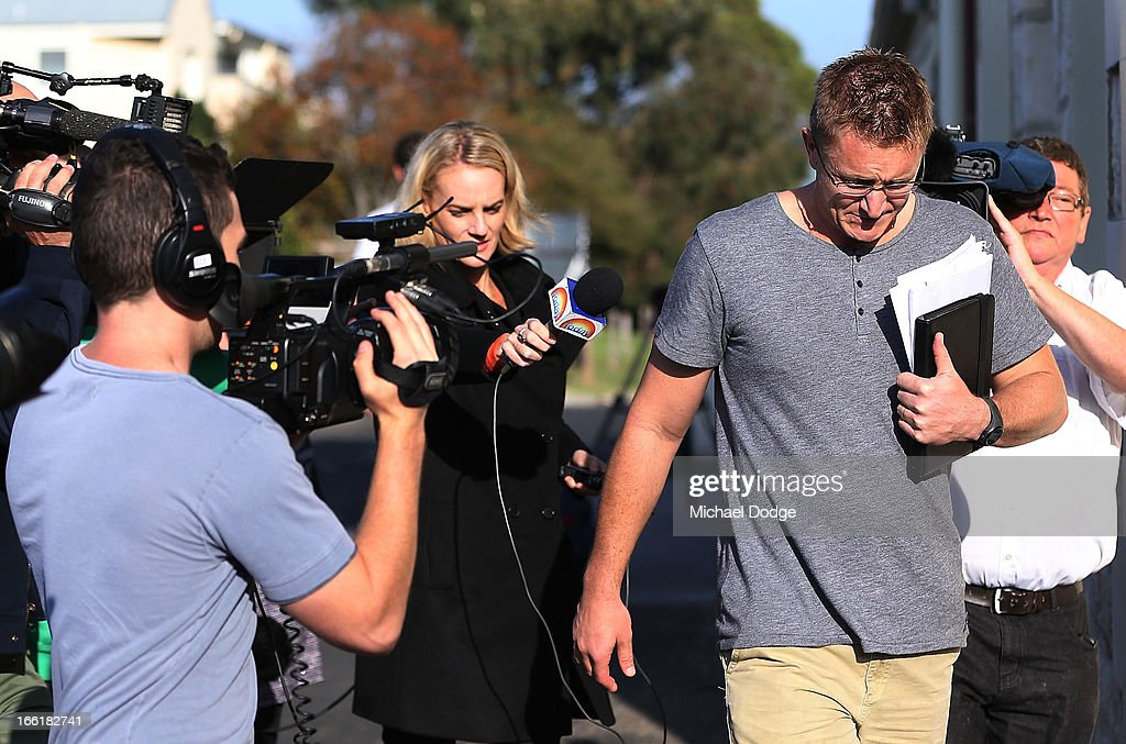 Demons coach Mark Neeld is seen walking away from a media reporter during a camp for Melbourne Demons AFL players and coaching staff at Sorrento on April 10, 2013 in Melbourne, Australia.