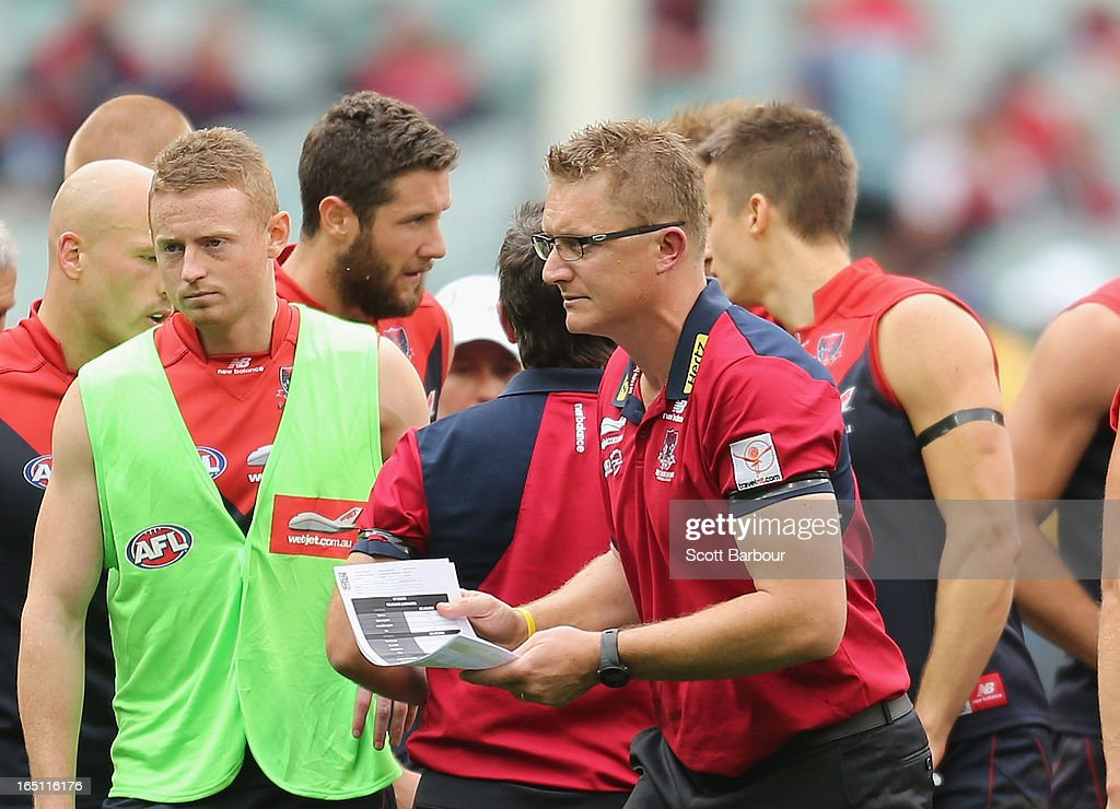 Demons coach Mark Neeld leaves after speaking to his team at three-quarter time during the round one AFL match between the Melbourne Demons and Port Adelaide Power at the Melbourne Cricket Ground on March 31, 2013 in Melbourne, Australia.