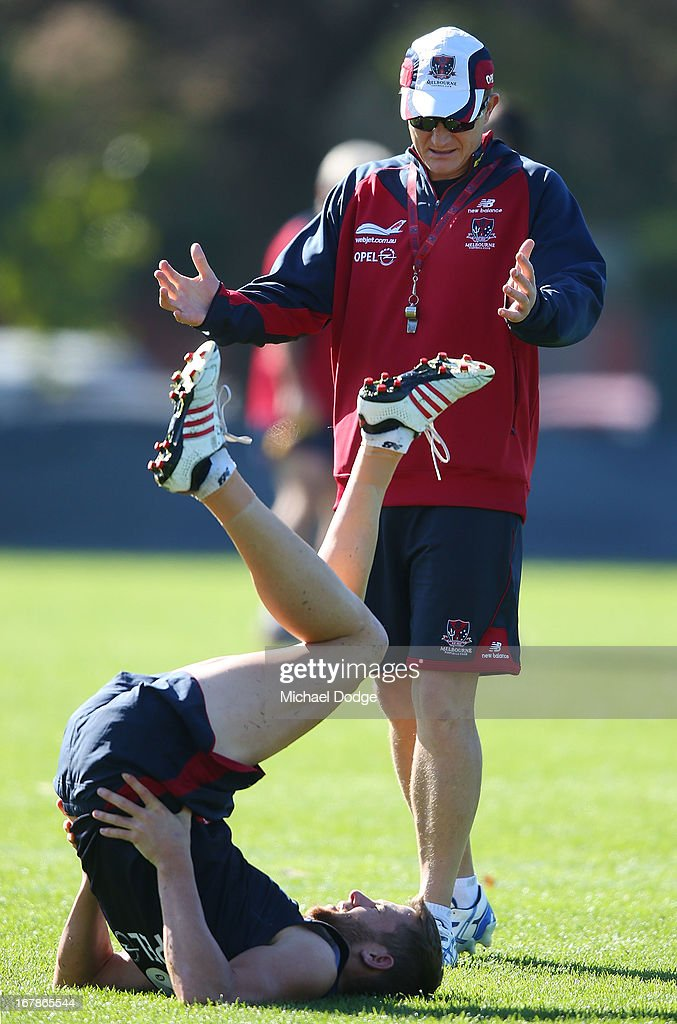 Demons coach Mark Neeld speaks to Jeremy Howe during a Melbourne Demons AFL training session at Gosch's Paddock on May 2, 2013 in Melbourne, Australia.