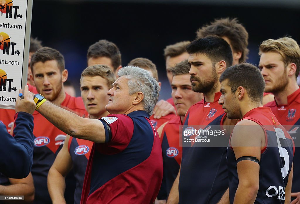 Demons coach Neil Craig speaks to his team as Chris Dawes and Jack Watts look on during the round 18 AFL match between the Melbourne Demons and the North Melbourne Kangaroos at Etihad Stadium on July 27, 2013 in Melbourne, Australia.