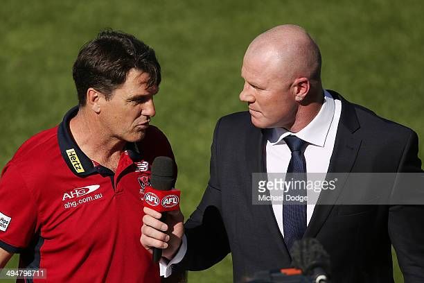 Demons coach Paul Roos is interviewed by Barry Hall of Fox Footy during the round 11 AFL match between the Melbourne Demons and the Port Power at...