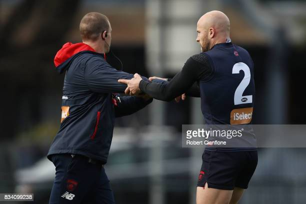 Demons coach Simon Goodwin and Nathan Jones performs drills during a Melbourne Demons AFL training session at Gosch's Paddock on August 18 2017 in...