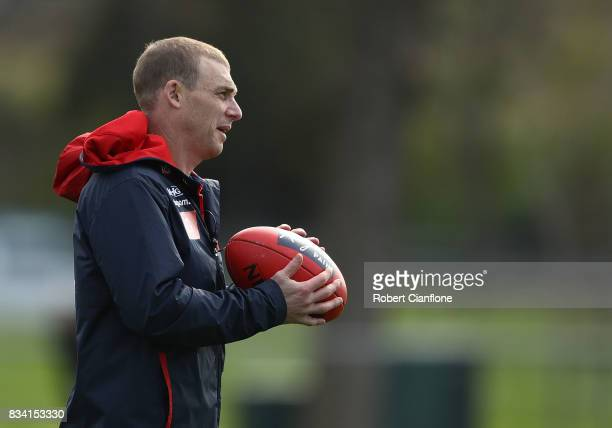 Demons coach Simon Goodwin looks on during a Melbourne Demons AFL training session at Gosch's Paddock on August 18 2017 in Melbourne Australia