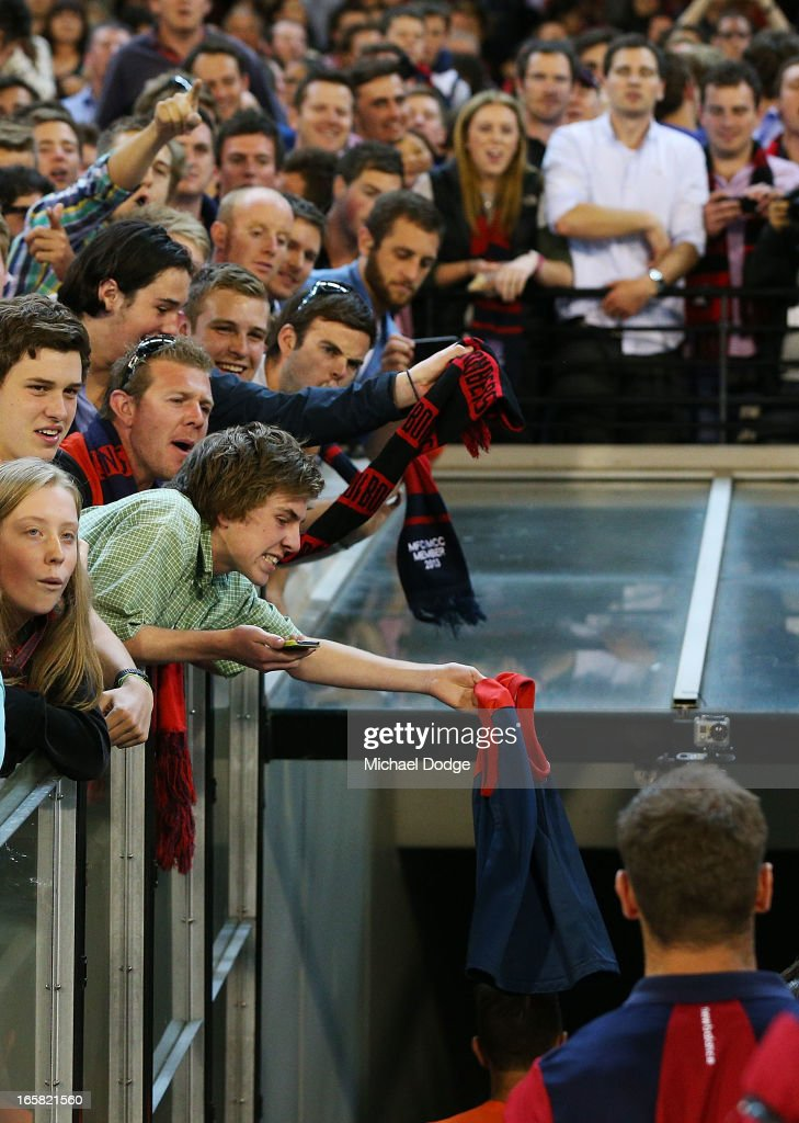 A Demons fan angrily waves a Demons jumper to club officials who walk to the rooms after a big loss during the round two AFL match between the Essendon Bombers and the Melbourne Demons at Melbourne Cricket Ground on April 6, 2013 in Melbourne, Australia.
