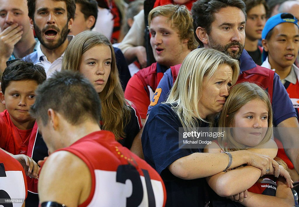A Demons fan cries after the game as Jack Grimes walks to the rooms after a big loss during the round two AFL match between the Essendon Bombers and the Melbourne Demons at Melbourne Cricket Ground on April 6, 2013 in Melbourne, Australia.