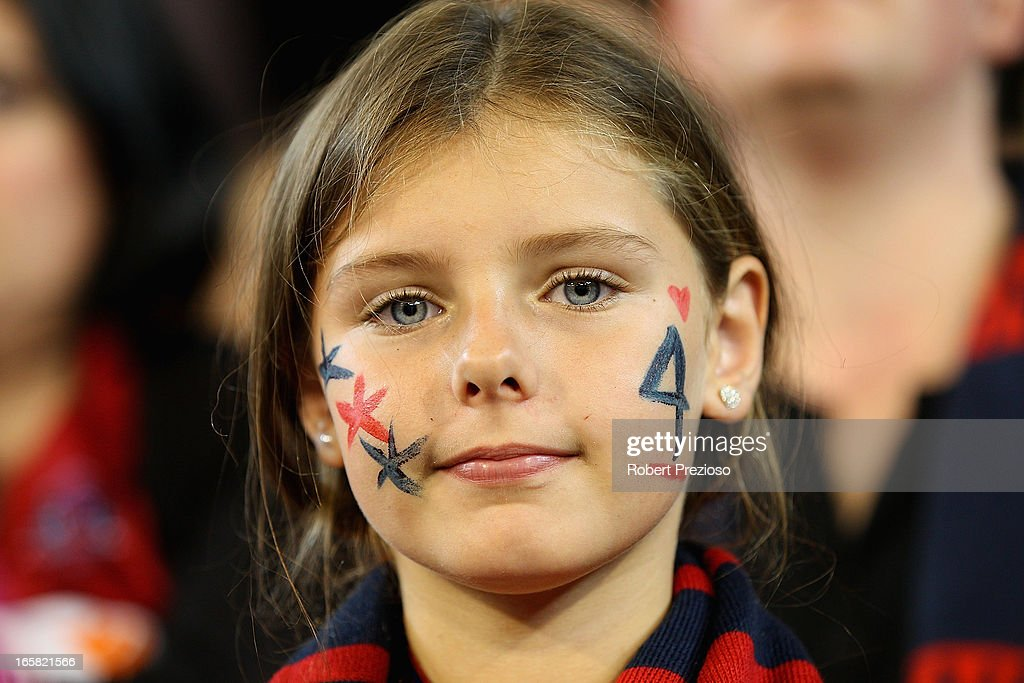 A Demons fan looks on during the round two AFL match between the Essendon Bombers and the Melbourne Demons at Melbourne Cricket Ground on April 6, 2013 in Melbourne, Australia.