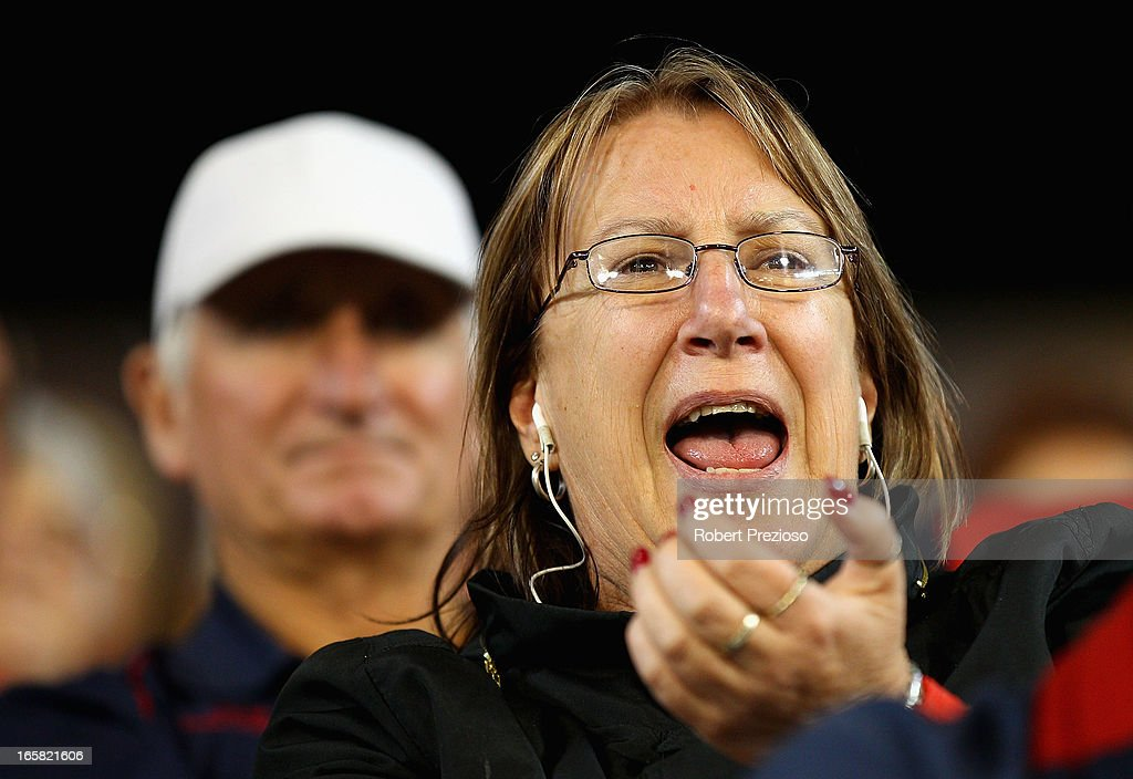 A Demons fan reacts during the round two AFL match between the Essendon Bombers and the Melbourne Demons at Melbourne Cricket Ground on April 6, 2013 in Melbourne, Australia.