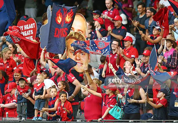 Demons fans in the crows celebrate after winning the NAB Challenge AFL match between the Melbourne Demons and the St Kilda Saints at Etihad Stadium...