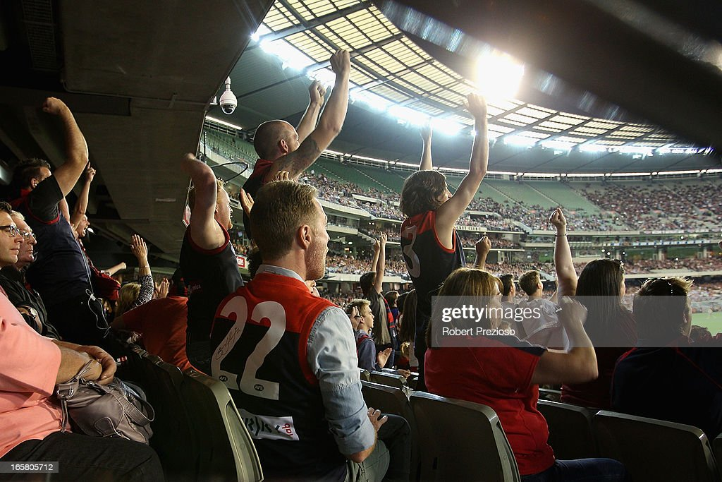 Demons fans show their support during the round two AFL match between the Essendon Bombers and the Melbourne Demons at Melbourne Cricket Ground on April 6, 2013 in Melbourne, Australia.