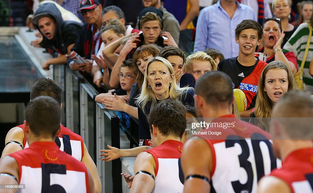 Demons fans try to motivate the players at half time during the round two AFL match between the Essendon Bombers and the Melbourne Demons at Melbourne Cricket Ground on April 6, 2013 in Melbourne, Australia.