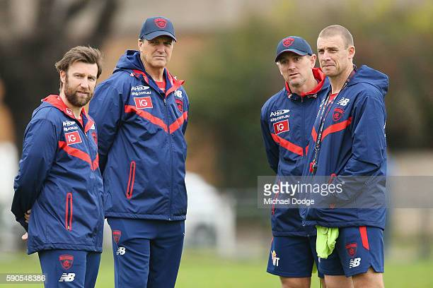 Demons head coach Paul Roos and assistant coach Simon Goodwin look on during a Melbourne Demons AFL training session at AAMI Park on August 17 2016...