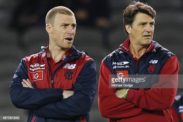 Demons head coach Paul Roos looks upfield with his assistant Simon Goodwin during the round 23 AFL match between the Melbourne Demons and the Greater...