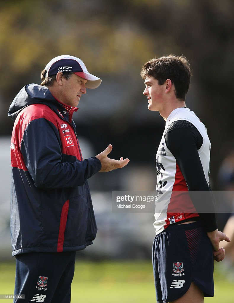 Demons head coach Paul Roos speaks to Angus Brayshaw of the Demons during a Melbourne Demons AFL training session at AAMI Park on July 22, 2015 in Melbourne, Australia.