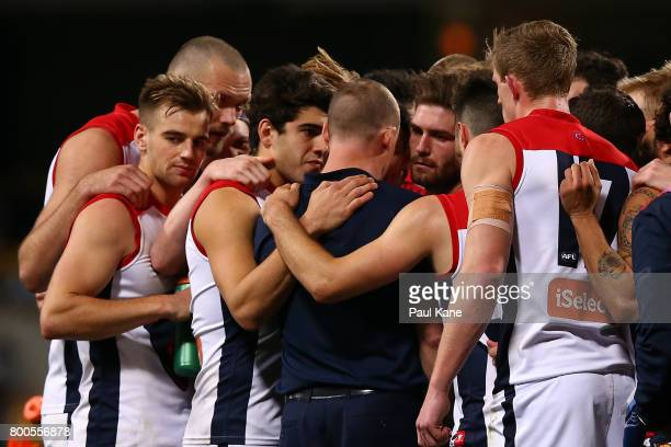 Demons head coach Simon Goodwin addresses his players at the three quarter time break during the round 14 AFL match between the West Coast Eagles and...