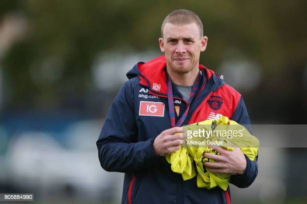 Demons head coach Simon Goodwin looks ahead during a Melbourne Demons AFL training session at Gosch's Paddock on July 3 2017 in Melbourne Australia