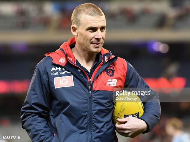 Demons head coach Simon Goodwin looks on during the round 15 AFL match between the Melbourne Demons and the Sydney Swans at Melbourne Cricket Ground...