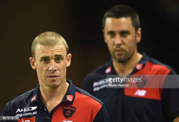 Demons head coach Simon Goodwin walks out onto the field during the round one AFL match between the St Kilda Saints and the Melbourne Demons at...