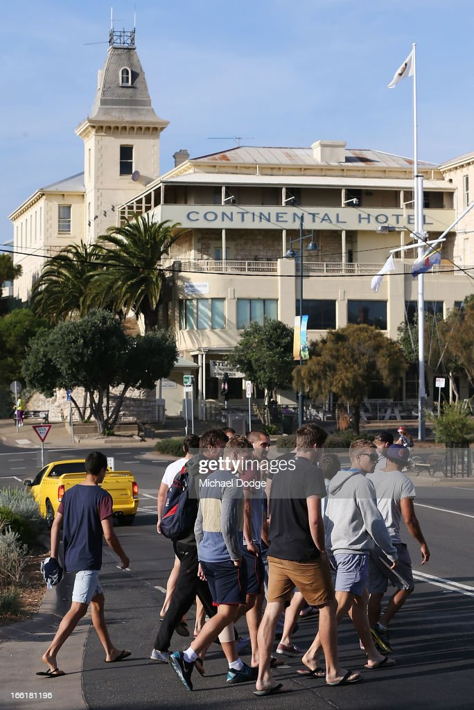 Demons players are seen walking past the Continental Hotel during a camp for Melbourne Demons AFL players and coaching staff at Sorrento on April 10, 2013 in Melbourne, Australia.