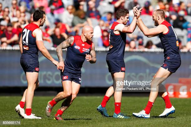 Demons players celebate a goal to Cameron Pedersen of the Demons after a goal assist to Jesse Hogan of the Demons during the round 22 AFL match...
