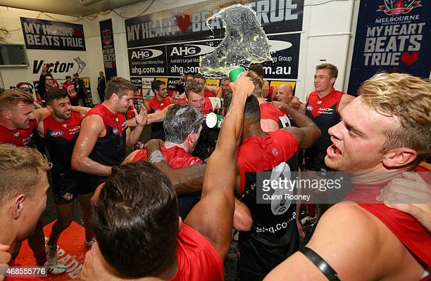 Demons players celebrate in the rooms after winning the round one AFL match between the Melbourne Demons and the Gold Coast Suns at Melbourne Cricket...