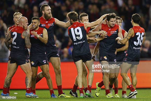 Demons players celebrates a goal by Jesse Hogan during the round 23 AFL match between the Melbourne Demons and the Greater Western Sydney Giants at...