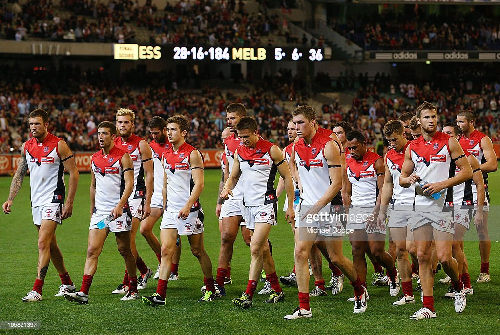 Demons players walk to the rooms after a big loss during the round two AFL match between the Essendon Bombers and the Melbourne Demons at Melbourne Cricket Ground on April 6, 2013 in Melbourne, Australia.
